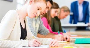 students writing test or exam